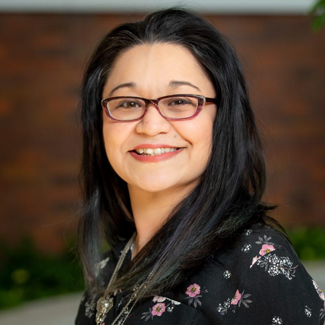 Dr. Mitzi Ramos